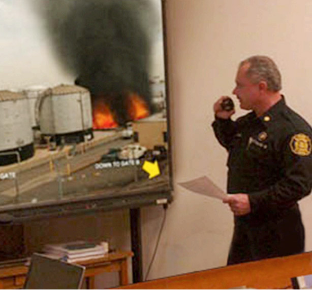 officer talking on radio in virtual fire simulation